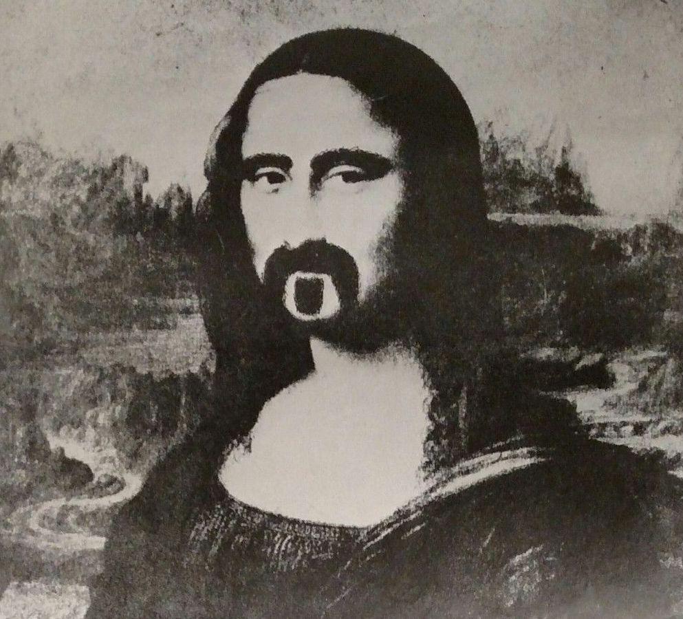 Scherzbild: Schwarz-weiß-Darstellung der Mona Lisa, deren Gesicht aber mit Augenbrauen und dem charakteristischen Bart von Frank Zappa verfremdet ist