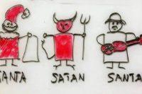 Cartoon: Drei Männchen in einer Reihe: Santa - Satan - Santana, mit den entspr. Attributen Mütze + Sack, Peitsche und Spitzgabel, und Gitarre